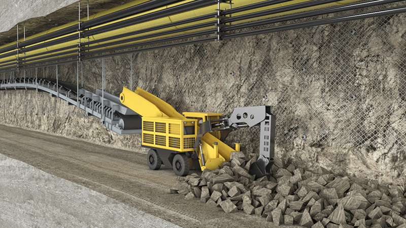 Haggloader loading material onto conveyor, Gold Mine in Mexico